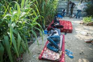 Migrants rest while hiding from Moroccan police on the outskirts of Tangiers on September 3, 2018.  By FADEL SENNA (AFP)