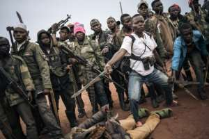 Militiamen, including children, of the armed group Codeco.  By ALEXIS HUGUET (AFP)