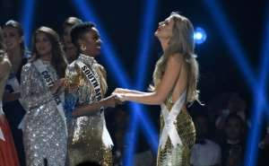 Miss South Africa Zozibini Tunzi (L) and Miss Puerto Rico Madison Anderson (R), the two finalists, wait to hear the winner's name on stage during the 2019 Miss Universe pageant at the Tyler Perry Studios in Atlanta, Georgia.  By VALERIE MACON (AFP)