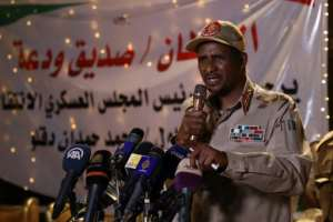 Mohamed Hamdan Dagalo -- also known as Himeidti and deputy head of Sudan's ruling military council -- speaks to the press in Khartoum in May.  By STR (AFP/File)