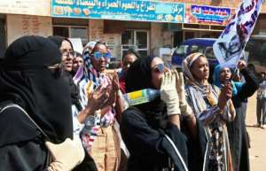 More than 100 protesters were chanting anti-government slogans, waving the Sudanese flag and burning car tyres.  By Ebrahim HAMID (AFP)