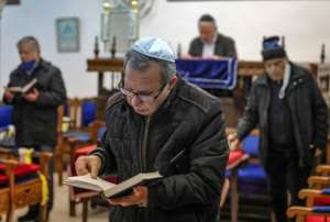 Moroccan Jews, pictured here praying at Casablanca's Em Habanim synagogue, are a community that dates back to antiquity.  By FADEL SENNA (AFP/File)