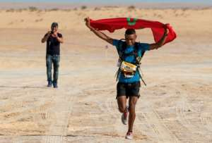 Moroccan Mohamed el-Morabity wins Tunisia's first ever ultra-marathon in the desert near the southwestern city of Tozeur on October 7, 2017
