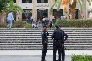 Moroccan security forces stand guard outside a court during the trial of Hajar Raissouni, a Moroccan journalist of the daily newspaper Akhbar El-Youm, who was on Monday sentenced to a year in prison for an illegal abortion.  By - (AFP)