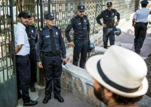 Moroccan security forces stand guard outside a Rabat courthouse where the trial of Hajar Raissouni on September 9, 2019 for alleged abortion.  By FADEL SENNA (AFP)
