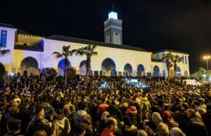 Moroccans have gathered at weekly demonstrations outside a mosque asking for support in the economic crisis.  By FADEL SENNA (AFP)