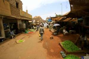 Most Khartoum businesses remain shut leaving the few shoppers who venture out dependent on the central market.  By - (AFP)