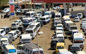 Motorists queue to fill up with petrol in Sudan where the economy is still reeling a year since the ouster of former autocratic leader Omar al-Bashir.  By ASHRAF SHAZLY (AFP/File)