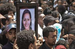 Mourners in Addis Ababa, Ethiopia carry portraits of victims from the Ethiopian Airlines crash. By Samuel HABTAB (AFP)