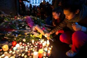 Mourners leave candles in memory of the 130 people killed in the Paris attacks in November 2015.  By JOEL SAGET (AFP/File)