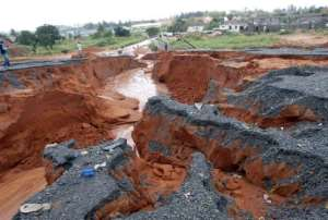 A road washed away by torrential rainfalls in Maputo is pictured on January 15, 2013.  By  (AFP/File)