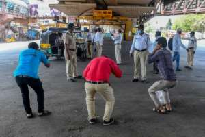 Mumbai police order people to do sit-ups as punishment for going out without a valid reason during a government-imposed nationwide lockdown in India.  By INDRANIL MUKHERJEE (AFP)