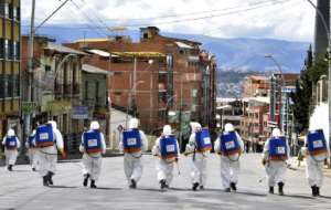 Municipal workers disinfect the streets of La Paz, Bolivia, as a preventive measure to slow the spread of the novel coronavirus, COVID-19.  By Aizar RALDES (AFP)