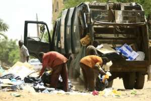 Municipality workers were out cleaning the streets of Khartoum after the strike ended.  By - (AFP)