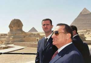 Mubarak with his Syrian counterpart Bashar al-Assad (L) at the pyramids in Giza in 2002.  By - (MENA/AFP/File)