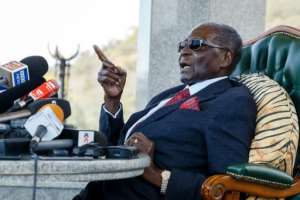 Mugabe, in a lengthy press conference on Sunday, called for voters to toss out his ZANU-PF party, which has ruled Zimbabwe since independence.  By Jekesai NJIKIZANA (AFP)