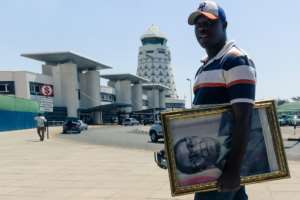 Mugabe's supporters arrived at the airport to welcome his body home.  By Jekesai NJIKIZANA (AFP)
