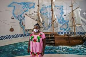 Museum guide Angelica Sorrosa believes it's important that future generations know about Afro-Mexican history.  By PEDRO PARDO (AFP)