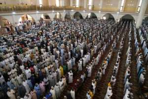 Muslim faithful at Friday prayers in the National Mosque in Abuja, Nigeria's capital.  By Kola Sulaimon (AFP)