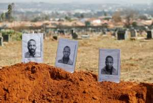 Mute Nyanya Yawa, Katyana Zoya and Mpitizeli Zoya shared a grave in Mamelodi West Cemetery, where black executed prisoners were buried under apartheid. By Phill Magakoe (AFP/File)