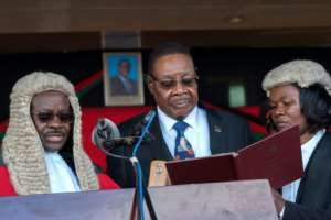 Mutharika was sworn in on Tuesday, a day after the delayed result was announced.  By AMOS GUMULIRA (AFP)