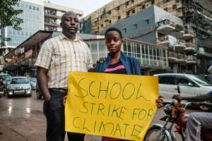 Namugerwa, seen with her father and agent Lukwago Cephas, says some people have criticised her, telling her she should be at school rather than striking -- but her parents have encouraged her.  By SUMY SADURNI (AFP/File)