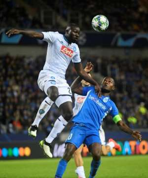 Napoli defender Kalidou Koulibaly (L) - a former Genk player - wins an aerial challenge as Samatta looks on. The sides drew 0-0 earlier this month in Belgium.  By JOHN THYS (AFP/File)