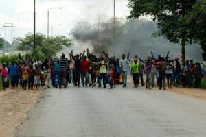 Nationwide demonstrations in Zimbabwe erupted January 14, 2019, after President Emmerson Mnangagwa announced that fuel prices were being doubled in a country suffering regular shortages of fuel, food and medicine.  By Jekesai NJIKIZANA (AFP/File)