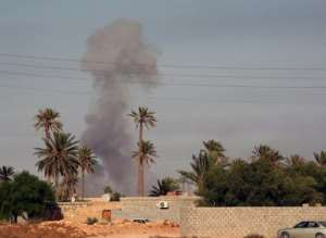 Amnesty International has called on NATO to investigate the killing of civilians in airstrikes in Libya last year.  By Mahmud Turkia (AFP/File)