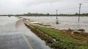 Near the small village of Mieze, floodwaters swamp the main road from Pemba.  By Emidio Jozine (AFP)
