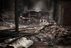 Nearly 50 shops in Bangui's PK5 district were gutted by a fire deliberately started after a fight between militia groups during a football match.  By FLORENT VERGNES (AFP)