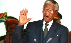 Nelson Mandela takes the oath on May 10, 1994 to become South Africa's first black president.  By WALTER DHLADHLA (AFP/File)