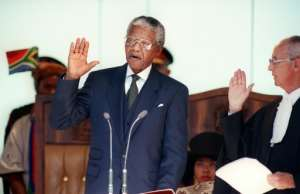 Nelson Mandela took oath as South Africa's first black president in May 1994.  By WALTER DHLADHLA (AFP)