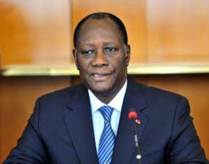 Ivory Coast's President Alassane Ouattara took the crucial post of defence minister in a new government.  By Sia Kambou (AFP/File)
