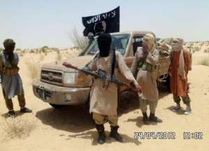 Islamist rebels of Ansar Dine are pictured near Timbuktu.  By Romaric Ollo Hien (AFP/File)