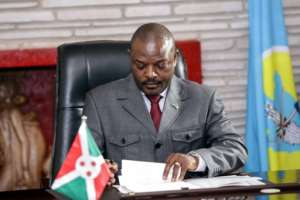 Nkurunziza on Thursday signed papers implementing the new constitution -- critics say the new charter is a vehicle enabling him to stay in power.  By STR (AFP)