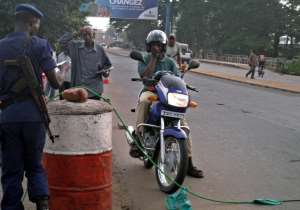 A motorbike-taxi operator in Burundi's capital Bujumbura stopped at a police road-block, in January.  By Esdras Ndikumana (AFP/File)