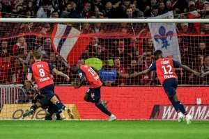 Nicolas Pepe converted a penalty for Lille to score his fifth goal of the season.  By PHILIPPE HUGUEN (AFP)