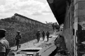 Nigerian federal army soldiers patrol near the destroyed prison of Calabar, the oldest port on the West African coast.  By Colin HAYNES (AFP/File)