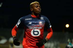 Nigerian forward Victor Osimhen celebrated after scoring for Lille at Angers but was later injured.  By JEAN-FRANCOIS MONIER (AFP/File)