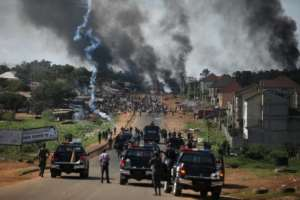 Nigerian police fire tear gas as youths protest in the capital Abuja.  By Kola Sulaimon (AFP)