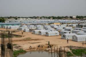 Nigeria's brutal 10-year insurgency has seen hundreds of thousands of displaced people flood into camps in Maiduguri to escape rural violence.  By FATI ABUBAKAR (AFP/File)