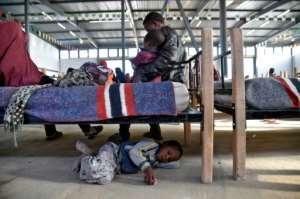 Nigerien migrants await repatriation at a transit camp in Laghouat, northern Algeria on June 29, 2018.  By RYAD KRAMDI (AFP)