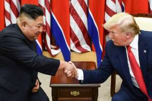 North Korea's leader Kim Jong Un (L) and US President Donald Trump shake hands at a meeting south of the Military Demarcation Line that divides North and South Korea in June 2019 -- their summits have been historic, if not full of concrete results.  By Brendan Smialowski (AFP/File)