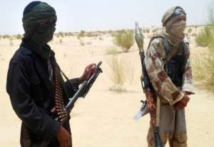 Islamist Ansar Dine rebels pictured near Timbuktu in rebel-held northern Mali in April.  By Romaric Ollo Hien (AFP/File)