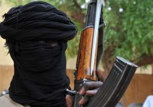 A fighter of the Islamist group Movement for Oneness and Jihad in West Africa (MUJAO).  By Issouf Sanogo (AFP/File)