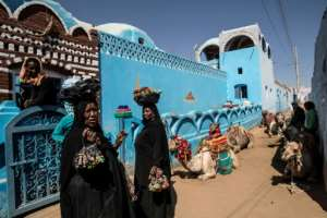 Nubian Egyptian women sell souvenirs in the village of Gharb Suhail near Aswan.  By Khaled DESOUKI (AFP)