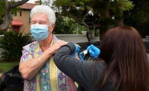 Nurse Liliana Ocampo administers the Moderna Covid-19 vaccine into the arm of Sister Pat Foster in Los Angeles.  By Frederic J. BROWN (AFP)