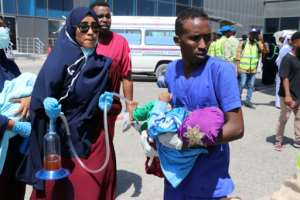 Nurses help a child wounded in the December 28, 2019 car bomb explosion in Mogadishu before being evacuated to Turkey for medical treatment.  By Abdirazak Hussein FARAH (AFP/File)