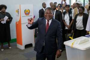 Nyusi is forecast to win a second five-year termdespite his popularity taking a hit from chronic unrest and a financial crisis linked to alleged state corruption.  By GIANLUIGI GUERCIA (AFP)